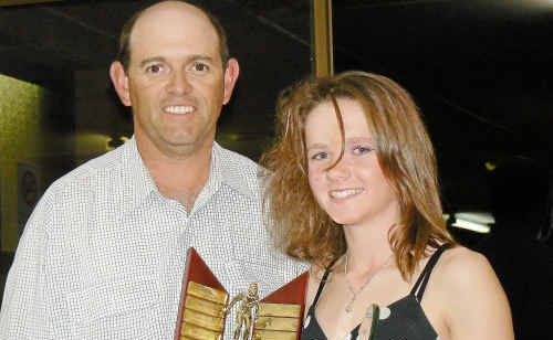 Warwick Swimming Club president David Fearby presents Dimity Brackin with the J and L Lancaster Trophy at the club presentation night.