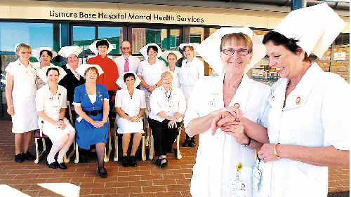 Nurses from the Lismore Base Hospital Mental Health Unit celebrate International Nurses Day by donning Florence Nightingale outfits. Pictured are nurses Michele (front left) and Paule with (seated, from left) Merilyn, Kathie, Narelle and Colleen; and (rear, from left) Pauline, Cherie, Jodi, Director of Nursing and Midwifery Beryl Jordan, Michael, Joanne, Sarah and Beth.