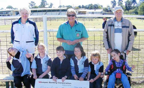 (Back from left) Lions representatives Brenda Black, Ros Keim and Neville Black donated $500 to the Warwick Riding for the Disabled Association pupils Jacob Laurie, Hayley Mead, Tyler Nicol, Brittany Clay, Rachel Walker and Bailey Flanagan.