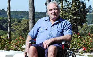 Grave difficulty: Errol Sawtell was upset when he could not visit his wife's grave due to inadequate wheelchair access at the Lismore Lawn Cemetery.