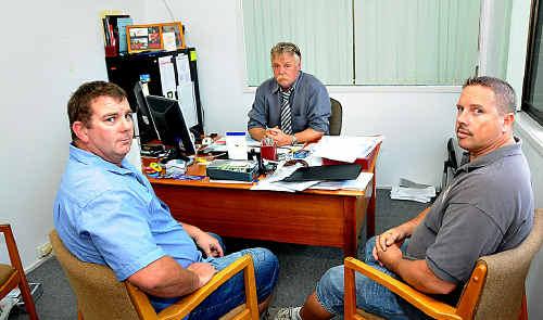 Concern for everyone: Trucking website operator Michael Hogg, Roadcraft's Peter Leupold and concerned truckie Brendan Blatchly at Roadcraft this week.