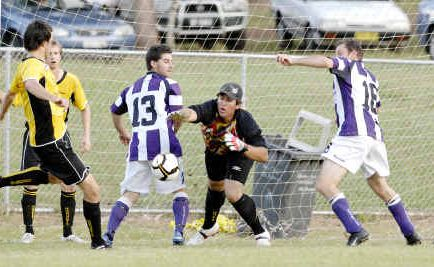Goonellabah goalkeeper Brad Robertson battles to prevent Pottsville scoring in the game at Weston Park, Goonellabah, last Saturday. The home team won 3-2.