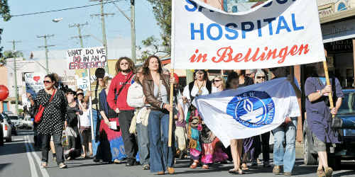 Show of support: Nurses lead a protest march through Bellingen's main street following the health rally.