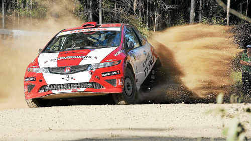Kicking up some dust: Eli Evans and Glen Weston in their Honda Civic nearly missed the corner, as this dramatic picture shows.