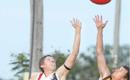 North Mackay's Shaun Carter, left, and City Hawks' Greg Farmilo fly high for the ball at Zeolla Park.