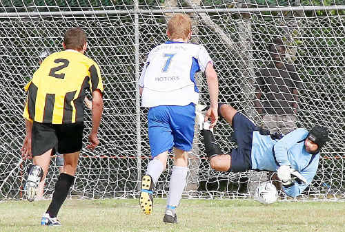 Yamba goalkeeper Rod Menzies saves a penalty shot against Northern Storm on Sunday. Unfortunately for Menzies and the Breakers he was given a red card not long after this moment of glory.