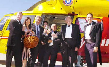 On song: Looking forward to the opera are (from left) Andrew Stewart, from the Westpac Rescue Helicopter, helicopter service receptionist Brooke Leeson, Lismore Central Rotary chairman Paul Denmeade, Carol Wheatley, from the Lismore Rotary Club, Geoff Cawley, from Lismore Central Rotary, Bryan Wheatley, from Lismore Rotary, and rescue helicopter pilot Lynton Beggs.