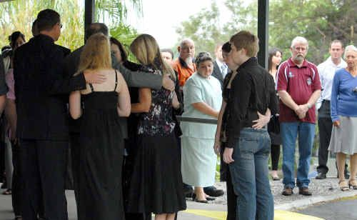 The family of Greg van Moolenbroek are consoled by a large gathering of relatives and friends just before farewelling the family man with a loveable nature at the Newhaven Crematorium.