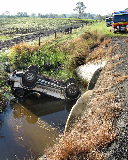 The driver of this Pajero was lucky to be alive yesterday after rolling into a ditch full of water. With just enough head space above water, he was able to grab a knife and cut himself free of his seatbelt.