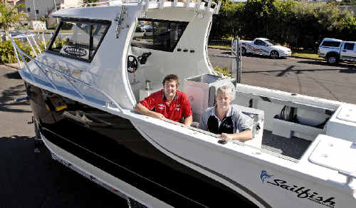 Sailfish Marine factory manager Craig Soward (left) and sales manager Ian Drew prepare the $140,000 2400 Gamefisher for the trip to the Sanctuary Cove International Boat Show that starts tomorrow.