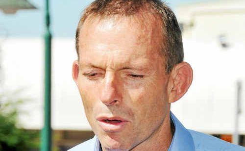 Federal Opposition Leader Tony Abbott in Goondoon St yesterday.