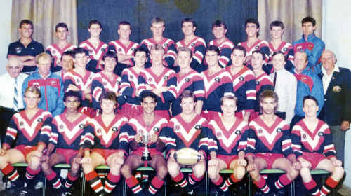 The Warwick Cowboys premiership winning under-18 side in 1990: (Front, from left) Richard Osborne, Richard Roberts, Peter Bland, James Jerome, captain Tony McGahan, Heath Hill, Alfie Boney, Dan O'Grady, (middle) patron Tony Maroon, co manager Paul Doyle, president Peter Small, Justin Anderson, Tony Roche, Todd Jefferies, Peter McMahon, Scott Mullaly, vice captain Craig Scanlan, Brett Blewitt, Tony Murphy, sponsor Mark Leith, co manager Peter Roser, secretary Kev Collins, (third row), coach David Abood, Kerry Scanlan, Phil Watts, Basil Nolan, Brad Watson, Paul Hilton, Mick Mundey, Brad Eyre, Nicholas Mapes, strapper Noel Loudon.
