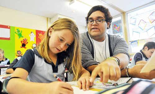 Soaking it up: Tyson Ferguson is teaching Corindi Public School students, including Luci Pointer, the native Gumbayngirr language.