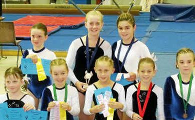 Level 2 gymnastics ribbon and medal winners (back, from left) Sharani Baker, Olivia Noble, Serena Wyllie, (front) Rosemary McDonald, Nikki Burraston, Emily Riley, Brittany Bailey and Emily Skelton after success for Warwick.