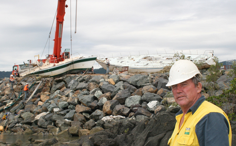 Some of the last tangible reminders of Cyclone Ului were removed yesterday with the wrecks of Anaconda II and Aquaholic salvaged from the rocks adjacent to the Whitsunday Sailing Club. Part owner of Aquaholic, Bob Dalby, was on the scene to farewell his yacht.