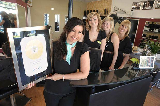 Rhonda Billett and staff at Nambour's Uptown Hair Studio.