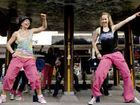 Dance on: Zumba Instructors Tessa Brauer (left), Josie Robertson and other flash mob dancers from Summit Sports and Fitness Centre stopped traffic in the middle of Woodlark Street yesterday in an effort to promote healthy lifestyle.