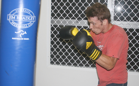 Iain Jacques shwoing determination two night's out from his bout at the Whitsunday PCYC.