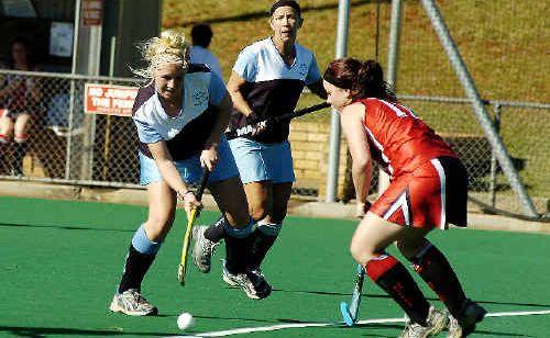 Ballina's Sarah Norton (left) tries to get past Alstonville's Kallie Seymour last Saturday. Ballina won 3-0.