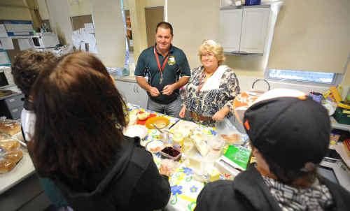 Maclean High School teachers Steve Woods and Sharon Tarrant help serve some students at the school's breakfast club.