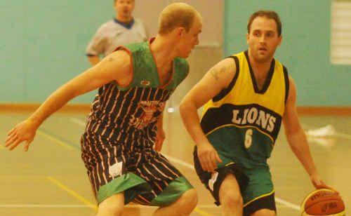 Matt Moran (left) drives Grafton Vikings against Armidale Lions at the Grafton Indoor Sports Stadium.