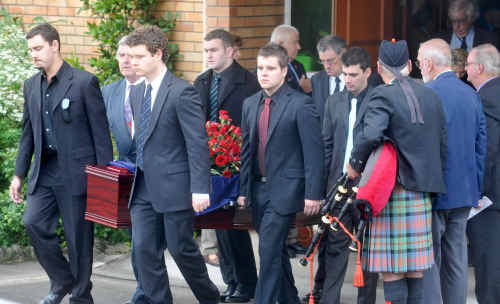The coffin of Don Day is carried from the Anglican Church in Maclean.