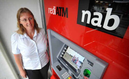 Branch manager of the NAB Maclean Pru Ensby with the newly installed ATM.