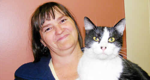 Maryanne Rogers holds the cat that had a close call yesterday morning after she was found in a box about to be squashed.