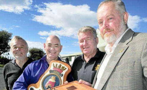 Keepsakes: Retired submariners Sam Serbert, Steve Conlon, Kevin Hayton admire souvenirs of HMAS Ovens with former Coffs Harbour City councillor and deputy mayor Ian Ovens.