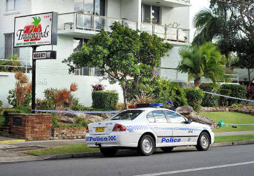Crime scene: Police converge on the Tradewinds Apartments on Monday.