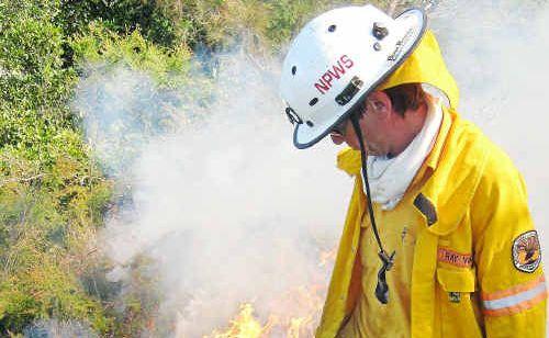 Strategic burning: NPWS Senior Field Officer Ray Ward begins the hazard reduction burn at Mullaway.