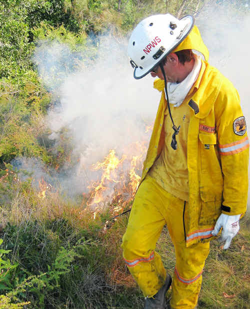 Strategic burning: NPWS Senior Field Officer Ray Ward begins the hazard reduction burn at Mullaway.