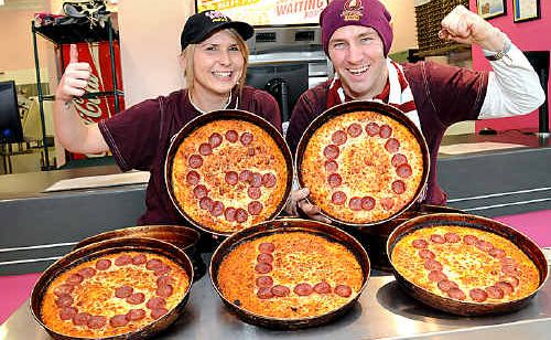 Richard Plukaard and Kaitlin McNeil at Eagle Boys Pizza in Gympie during the State of Origin.