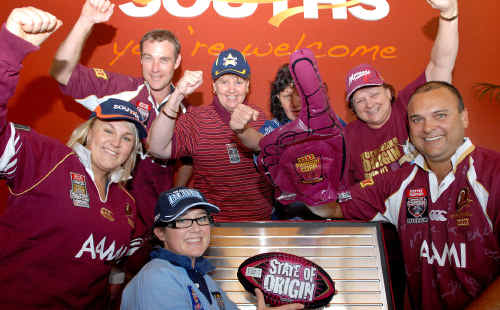 Taking sides in the lead-up to tonight's first rugby league State of Origin clash in Sydney are, back from left, Clayton Wallwork, Debbie Dunne, Robyn Turley and Sue James and, front from left, Bec Smith, Kasey Jennings and Kingsley Theiber.