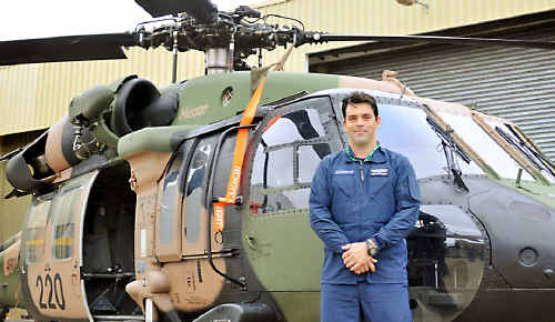 Black Hawk helicopter instructor Adrian Park shows off of the impressive machines at the Oakey Army Aviation Centre.