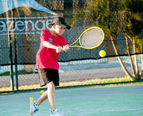 Young tennis player Matt Thompson goes through his paces during practise at Westside this week.