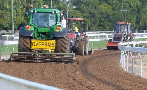 Machinery maintenance work is performed on the training track at the Grafton Racecourse.