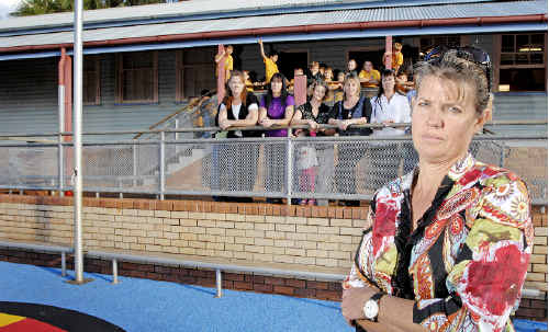 Wollongbar Public School P&C; president Susan Dyer and parents are outraged that under the Government's Building Education Revolution the school was told it would be allowed to build two new classrooms if the original schoolhouse was demolished.
