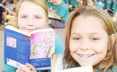 Gotta keep reading: Tyalla Public School students Brooke Cordell and Laela Davidson got into the spirit during the school's Library Week celebrations.