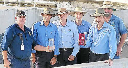 Winners: Ross Waugh holding a beaker of reclaimed water, Glenn O'Grady, Peter Buckingham, Adam Wilson, Simon Thorn with IPWEA award and Warren Nazzari.
