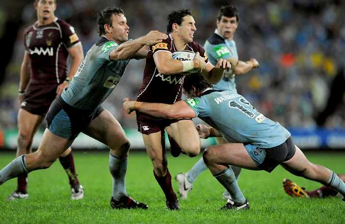 Queensland's Billy Slater is bailed up by two Blues players during Game 1 of the 2010 State of Origin.