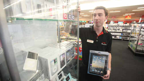 MATT Ottaviani of Harvey Norman with the Apple stand, and iPad accessories, but he doesn't know when he will have the real thing available for sale.