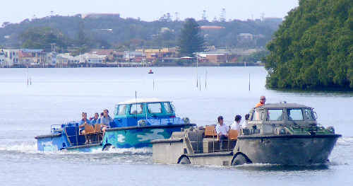 Two of Ballina High School's three light amphibious resupply cargo vessels on the Richmond River yesterday.