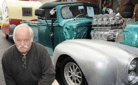 Dennis Watts of Alstonville shows off his 1942 Ford roadster pick-up and 1950's caravan at Saturday's Show 'n' Shine.