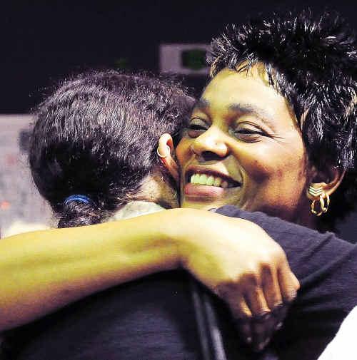 Smiles: A family hug to mark a joyous moment.