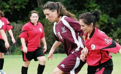 It's mine: Cassia McGlashan and her Urunga teammates were forced to work hard for their win by Coffs United.