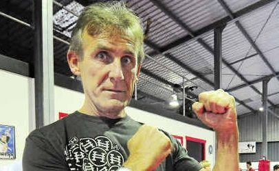 Randy Holeman takes students through some patterns at Diamond Martial Arts.