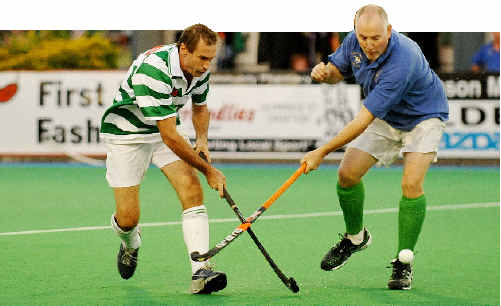 Cross sticks: Royals Irish player Dave Morrison (left) takes on a Royals Nevilles opponent.