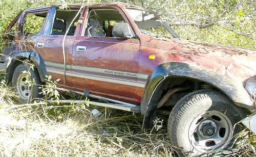 The car landed upright in thick bush on the creek bank on the side of the Dawson Highway.