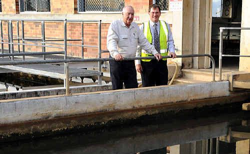 It's fluoride by New Years, according to a reluctant Council Works Committee chairman Larry Friske and Water and Sewerage manager Ian Schiefelbein, pictured at the Jones Hill water treatment plant.